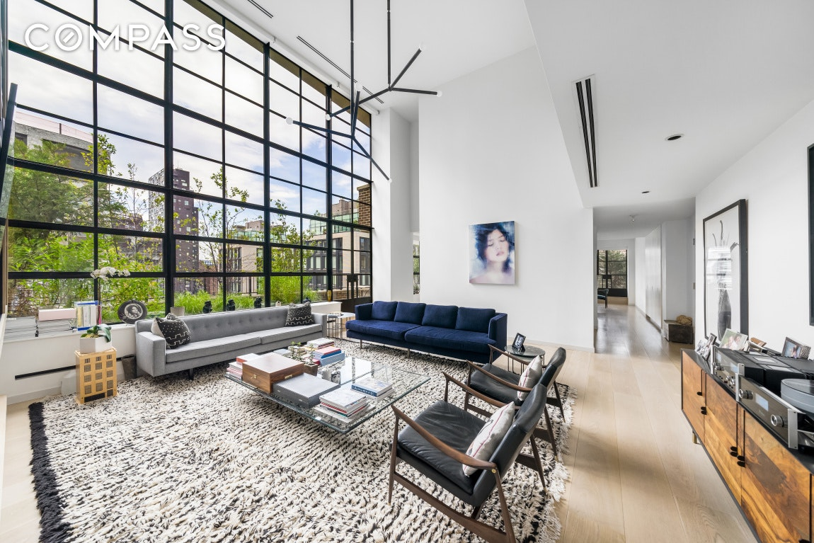 Bask in sun-filled splendor and iconic views in this three-bedroom, three-and-a-half bath penthouse duplex with 1,200 square feet of private outdoor space in a full-service West Chelsea condominium.  Wrapped in windows and terraces, this expansive 2,829-square-foot residence is bathed in sunlight and gorgeous views. Enjoy glimpses of the Hudson River and The High Line in the stunning double-height living room flanked by 20-foot-tall shelving, a gas fireplace and massive casement windows that open to the first of two wraparound terraces. The open chef's kitchen is beautifully equipped with custom birch cabinetry, Corian countertops and an army of Miele and Sub-Zero appliances. There's space for dining at the wide breakfast bar/island or in the adjacent dining area, and the wide terrace and gas grill just outside make al fresco dining and entertaining irresistible. A powder room, two large closets and a bedroom suite complete the first level.  Upstairs, the serene master suite oasis is encircled by its own terrace with views that sweep from the river to the Empire State Building. Rows of closets and a dressing room accommodate wardrobe, while the en suite marble bathroom is filled with a freestanding soaking tub, dual rain shower heads aromatherapy steam shower, and double vanity. A laundry closet with a Miele washer-dryer leads the way to the home's third complete bedroom suite. Sustainably sourced wide-plank white oak paves the floors while multi-zoned central air and a full-home automation system with climate, music, fireplace, blinds and light controls add effortless comfort and ease to this special West Chelsea penthouse.  Designed by architect Cary Tamarkin, 456 West 19th Street sets a new standard for sophistication and sustainability in West Chelsea. The LEED-certified building offers a 24-hour doorman, on-site superintendent, garden, storage and bike room. Perfectly positioned in the heart of the West Chelsea Arts District, this home is surrounded by The High